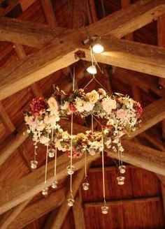 Silk flower and grapevine chandelier with hanging tea light votives. 36 inches in diameter, tea lights hang 12-24 inches from chandelier. Could use solar lights in votives ...