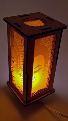 "$35 - Buddha Accent lamp: Perfect for your meditation area, or anywhere you want a little peace in your life. This unique accent lamp gives off a warm light through its engraved orange acrylic plates that features a buddha at peace on all four sides. A lotus medallion at the top gives off more light. This lamp uses a UL listed candelabra light socket and gives off just the right amount of light for meditation, mood lighting, or a reading light. Approx 11"" x 5"" x 5"""