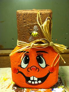 Pumpkin, for thanksgiving or Halloween By Family Affair Painted Bricks Crafts, Brick Crafts, Painted Pavers, Stone Crafts, Painted Pumpkins, Painted Rocks, Cement Pavers, Brick Pavers, Fall Crafts