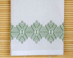 This tea towel, done with Country Grape Swirl thread, is created using the needle art of Swedish Weaving. The towel measures 23 x 13-1/2, 100% cotton and entirely hand-stitched. Use it as a dish towel, hand towel for guests, or any number of uses.  Completed in my smoke-free, pet-free home.