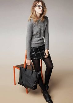 Madewell look: Crew neck sweater, short skirt and black tights.