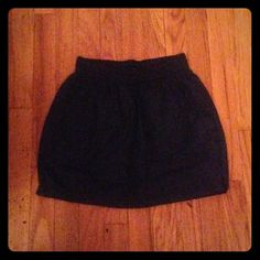AMERICAN APPAREL Navy Blue Nylon Skirt 100% nylon American apparel skirt. Two pockets. Great to wear with flat shoes or sandals. Can even dress up! Slight rips near bottom hem on each side. Can be repaired easily. Sold as is. Will bundle. American Apparel Skirts