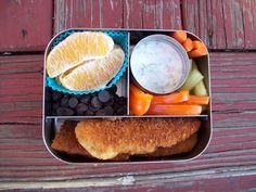 Today's @lunchbot: Chicken tenders, veggies w/tzatziki, orange segments, dark chocolate chips. #lunchboxideas