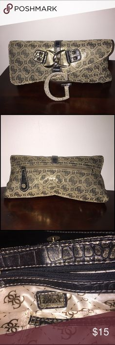 Golden Guess ladies clutch A beautiful Guess clutch has two zippers one at the back and one inside with a big G on the front as shown on the photo very clean inside like new has no signs of use Guess Bags Clutches & Wristlets