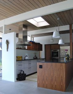 After - Foyer & Kitchen  this is a kitchen by Henrybuilt.  Do you have any experience with this kitchen cabinet maker?  We are considering this for our kitchen.