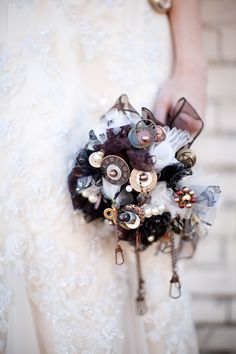 steampunk wedding bride inspiration hair makeup Gears, buttons, lace, hooks, and eyes could be worked between flowers of bridal bouquet. Steampunk Wedding Themes, Steampunk Theme, Victorian Steampunk, Steampunk Couture, Steampunk Fashion, Alternative Bouquet, Alternative Wedding, Dc Weddings, Romantic Weddings