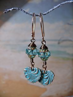 Week 2 - Pisces aqua artisan earrings. Beautiful aqua patinated solid bronze heart charms by Lesley Watt (THEAtoo) echoed by gorgeous aqua picasso czech glass turbine beads, all carefully wrapped by me with bronze wire and hung on solid bronze swan neck earwires by Faith Bowman (Abyjem).