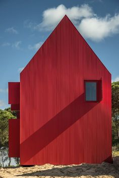 A FieryRed Home Sizzles With Simplistic, Modern Design is part of Unique home Design - This simple red house in Portugal appears as a signpost within its labyrinthlike, forested site Architecture Cool, Minimalist Architecture, Landscape Architecture, Metal Siding, Metal Roof, Building Costs, Building A House, Building Design, House Architecture