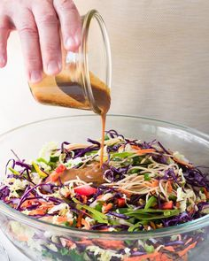 My vegan Asian Slaw with a creamy peanut dressing is a Chinese coleslaw with chow mein noddles that tastes so good you don't even realize how healthy it is.