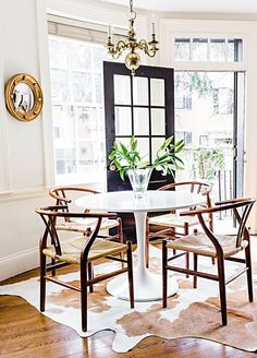 The dining room has plenty of light thanks to large windows.