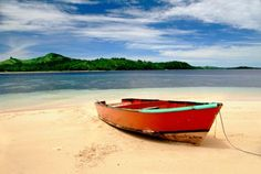 Red Boat on Beach by Richard Steinberger