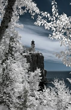 https://flic.kr/p/54TpyX   Splitrock Lighthouse, MN   This image was taken during a summer field trip by our family for a school project our daughter was working on. The image was captured by a modified Nikon D50 that only takes Infrared images. Worked on in PS to colorize and adjust horizon level and some tones of the lighthouse. Prints are available. Feel free to contact me @ coryshubert@gmail.com for size/price list.