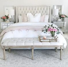 Bedroom inspiration, white bedding, bedroom decor, pink linen duvet cover, tufted linen bed, mirrored nightstands, gray pottery barn rug, grey rug, tufted bench, ruffle euro sham, pink roses, white bedroom, classic glam bedroom, home inspiration http://liketk.it/2uQAK #QualityBedLinen