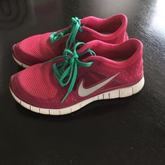 Nike free runs Pink Nike free runs with green laces. They show minimal signs of wear very comfy Nike Shoes Athletic Shoes