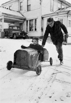 ∆ James Dean pushing family friend in box car, photographed by Dennis Stock, 1955.