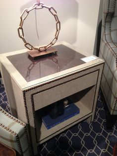 Linen, leather, and nail heads for versatile end table.