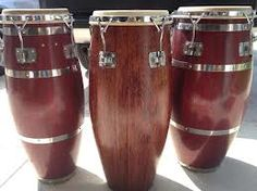 the  Gon Bops drums on L and R are Oak. An excellent used drum choice