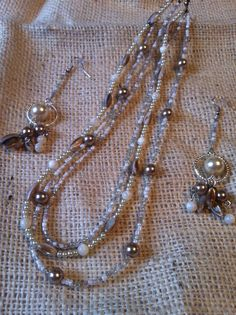 cream and pearl triple strand necklace with long chandelier earrings- facebook.com/stacie.dertinger
