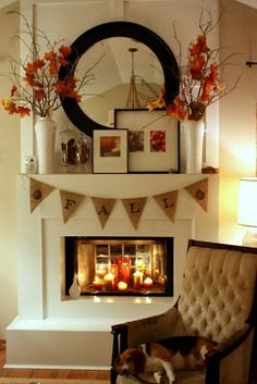 Cute fall fireplace mantel...watch those pennants though! They would be a fire hazard if they are that close to the firebox (assuming you burn in there).