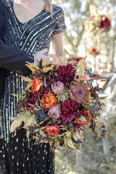 sparkle and jewel tone bouquet | Photo by Cassandra Castaneda Photography