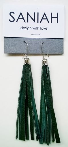 Hapsu earring with green leather and satin ribbons. Made of industrial surplus and recycled materials.