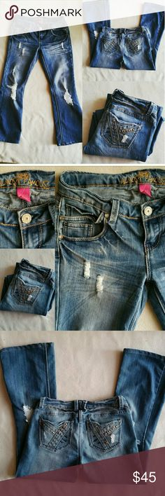 """ALMOST FAMOUS Distressed Low Rise Flare Jeans 7 Almost Famous distressed low rise flare jeans size 7. In excellent used condition. Bling rear pockets. Runs on the small side. 60% Cotton / 39% Polyester / 1% spandex. Flat lay measurements : 15"""" waist / 16"""" hip / 6.5"""" rise / 27"""" inseam. Please let me know if you have any questions. 30% discount when using the bundle feature. No trades! Almost Famous Jeans Flare & Wide Leg"""