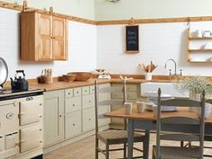 Shaker Kitchen with hanging upper cabinets and an Aga! Old Kitchen, Green Kitchen, Kitchen Colors, Kitchen Dining, Kitchen Ideas, Mission Style Kitchens, Shaker Style Kitchens, Cool Kitchens, Farmhouse Kitchens