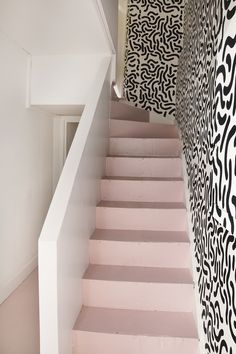 Staircase with black and white. Not sure I like the painted worm design but it's very on trend. #Blush. See more on the blog at YasminChopin.com.