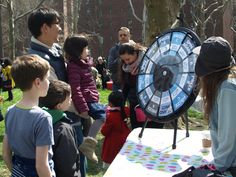 Families flock to Stuy Town's Easter egg hunt. Buy this Prize Wheel at https://PrizeWheel.com/products/tabletop-prize-wheels/tabletop-black-clicker-prize-wheel-12-slot/.