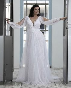 Prettiest 8 Plus Size Summer Wedding Dresses: Sexy plus size long summer wedding dress with sexy V-neck, long sleeves and flowy lace skirt by Darius Cordell