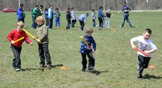 Young participants in the Cricket in Kitchener program (from left) Gareth Lawrence, Alan Lawrence, Evan Hughes and Hunter Bjorkenstam practise scoring runs on a field near the Williamsburg Community Centre in Kitchener.
