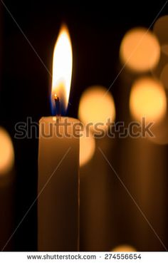 #closeup of a #burning #candle on a dark background with soft #lighting #microstockita