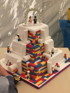 LEGO Wedding Cake Built Out of Tiny Fondant LEGO Bricks With Worker Minifigs Rolling Out a Final Layer of Icing