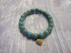 Turquoise bracelet 8mm turquoise beads gold plated by kikaystore, $12.99
