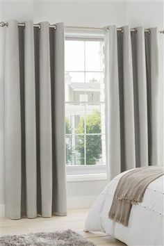 Buy Plain Blackout Eyelet Curtains from the Next UK online shop