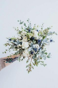 20 Gorgeous Winter Wedding Bouquets EmmaLovesWeddings is part of Green wedding bouquet - There's no bride without a bouquet! Every wedding theme and style usually supposes that a bride would carry a bouquet, so it's high time to Blue Wedding Flowers, Flower Bouquet Wedding, Wedding Blue, Bouquet Of Flowers, Boquette Flowers, Winter Flowers, Irish Wedding, Wedding Rustic, Something Blue Wedding