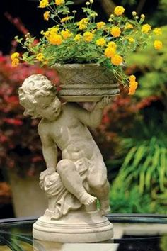 Cherub with removable basket of lantana from Charleston Gardens. Garden Urns, Garden Statues, Planter Garden, Garden Bed, Flowers Garden, Beautiful Gardens, Beautiful Flowers, Beautiful Gorgeous, Charleston Gardens