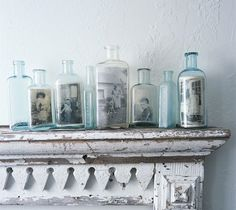 What a great way to display old photos and bottles...love it!