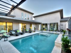 This courtyard pool has it all with an automatic pool cover, water feature, Pebble Tec, in floor cleaning system, glass tile, travertine deck.  #luxurypools #masterpoolsofaustin #atlantisplastering #austinpoolbuilders #modernpool #custompoolbuildersaustin #pebbletec #automaticpoolcover #luxurypoolsaustin #courtyardpool #masterpoolsguild www.masterpoolsofaustin.com
