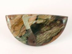Heres a cabochon of Morrisonite Jasper from Malheur County, Oregon. This fantastic stone was discovered in the 1940s and has not been mined since 1996 (and likely wont be again). Its known as the King of the Jaspers because of its highly varied coloring and outstanding patterns. I