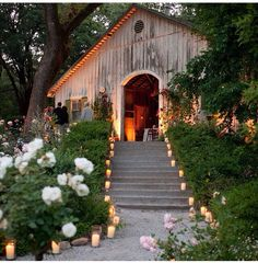 Found this on the knot's Instagram - love the distressed wood barn with the tea lights lighting the way.