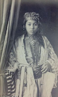 The images depict views of North Africa villages, landscapes and portraits of local people in traditional costume