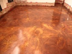 marble-stained concrete floors /   English Red, Malayan Buff, and Coffee Brown Acid Stains on DCI Overlay