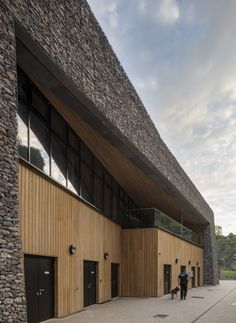 Stone-filled gabions provide the walls of this police training centre in a disused quarry.