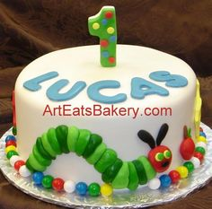 Google Image Result for http://www.arteatsbakery.com/images/The%2520very%2520hungery%2520caterpiler%2520custom%2520fondant%2520first%2520birthday%2520cake%2520with%2520number%25201%2520topper%2520and%2520the%2520food%2520he%2520ate.jpg