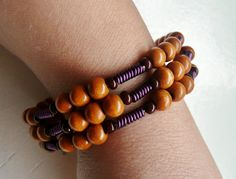Blond Wood and Purple Coil Memory Wire Set, comes with matching earrings for $15.00, via Etsy.
