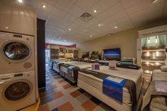 Mattress showroom.  Sealy. Posturepedic.  Sterns and Foster. Hybrid. Front load washers. Bosch.