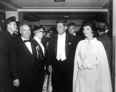 President John F. Kennedy and First Lady Jacqueline Kennedy arrive at the National Guard Armory for President Kennedy's Inaugural Ball - Washington, D.C. - January 20, 1961.