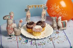 Coral & Tusk Birthday Raccoon caketopper and embroidered pals! With balloon and confetti from @greatlakesgoods !