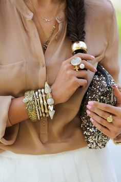 Gold accessories with pale pink nails